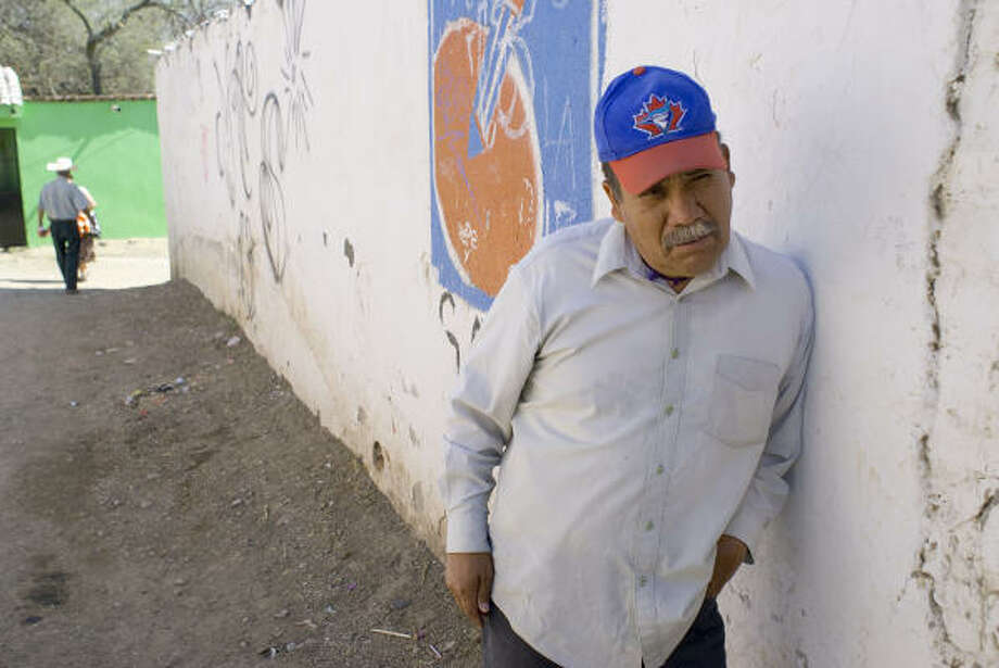 Ramon Aviña runs a government-owned grocery in Los Rodriguez. He depends on the GM factory's workers as customers. But with plant shutdowns, business is way off. Photo: Keith Dannemiller, SPECIAL TO THE CHRONICLE