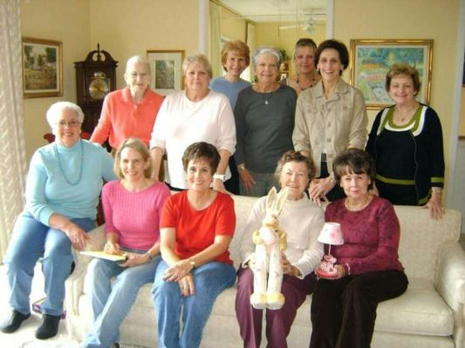 SUGAR CREEK GARDEN CLUB: Organizing the Magic Garden event are, from left, standing: Arlene Flak, Helen Rosenthal,  Susan McLaughlin, Charlotte Thomas, Baerbel O'Hara, Patty Pearson and Diane Reeves; seated, from left, are: Carol Beth Gore, Event Chairman Dana Knox, Jenny Schultz, Ginnie Russel and President Judy Johnson Photo: Courtesy, Sugar Creek Garden Club