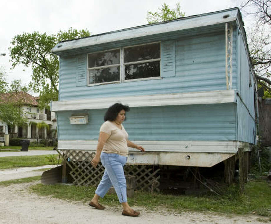 Lourdes Gutierrez stands outside her home this week in the Floyd mobile home park, where she has lived for the past 25 years. Photo: Brett Coomer, Chronicle