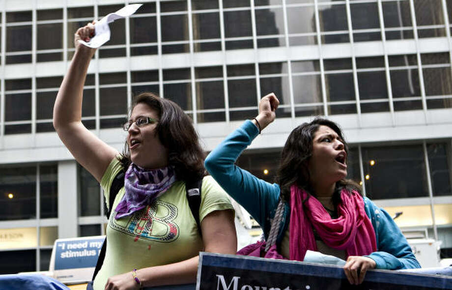 Maria Davila, left, and Ariana Basco demonstrate against Citigroup outside the New York Hilton Hotel, where Citi was holding its annual shareholders meeting on Tuesday. Photo: DANIEL ACKER, Bloomberg News