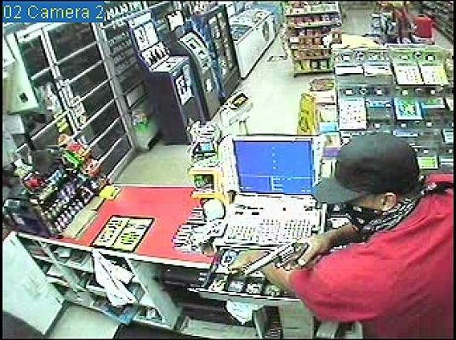 Police say this man robbed the Corner Store at 13406 Greenway Drive about 9:20 p.m. on June 26. Photo: Sugar Land PD