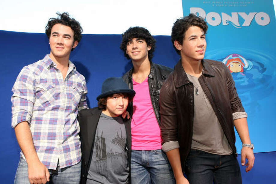 """Cast member Frankie Jonas (2nd L) and brothers (L-R) Kevin Jonas, Joe Jonas, and Nick Jonas of the Jonas Brothers arrive for the industry screening Of Walt Disney Pictures' """"Ponyo"""" at the El Capitan Theatre on July 27, 2009 in Hollywood, California. Photo: Kristian Dowling, Getty Images"""