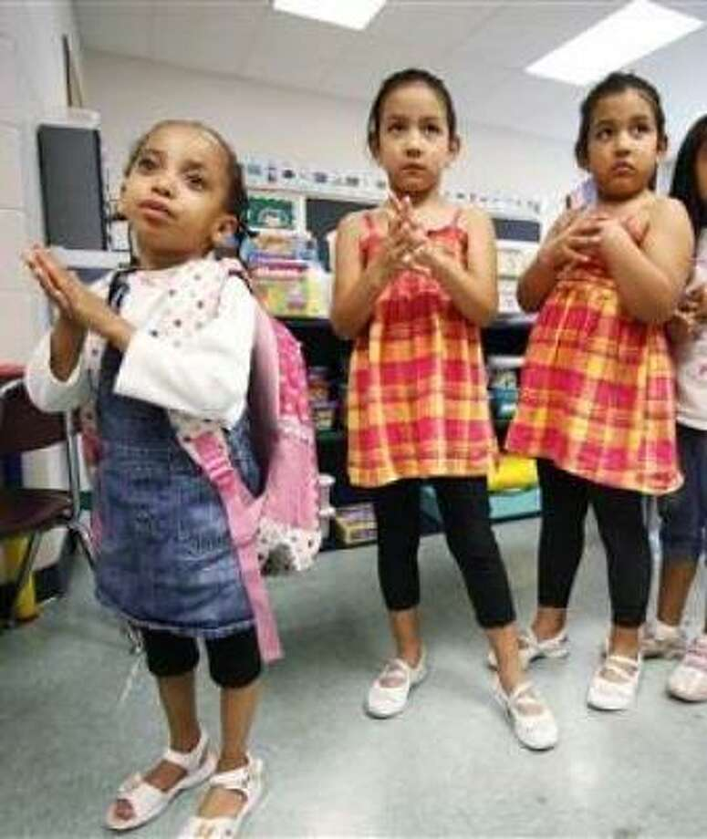 Kindergartners rubbing hand sanitizer this summer on their hands before going to lunch at a summer school program in Montgomery County, Md. Like employers, many schools are preparing for a swine flu outberak. Photo: Manuel Balce Ceneta, AP