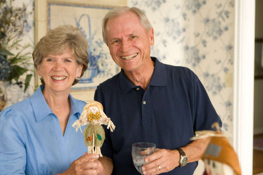 DOING SOMETHING FUN: Jack and Gayle Hillman show a craft project created by a senior who participates with The Gathering Place ministry based at Chapelwood United Methodist Church. The Hillmans volunteer with the ministry and spend time with the seniors group each month. Photo: R. Clayton McKee, For The Chronicle