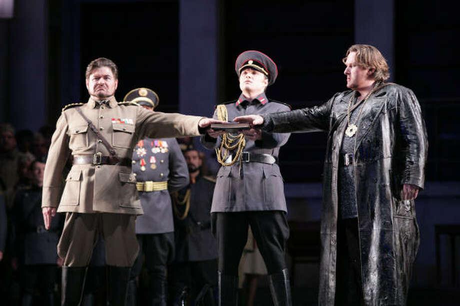 Richard Paul Fink (Frederick of Telramund), from left, Ryan McKinny (Herald) and Simon O'Neill (Lohengrin) star in the Wagner opera. Photo: Felix Sanchez