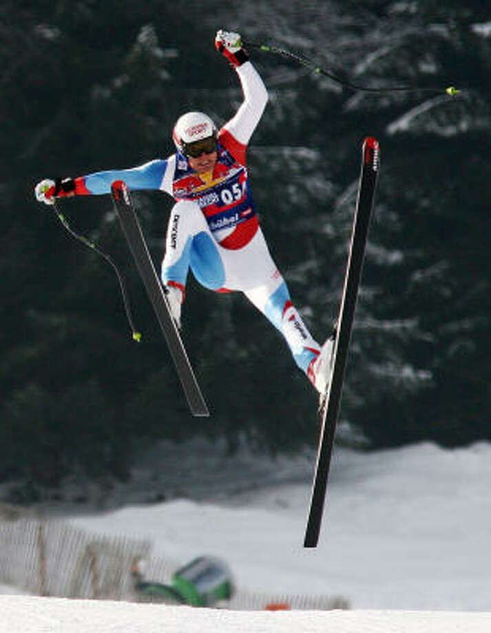 Daniel Albrecht lost control and flew through the air for about 130 feet. Photo: GIOVANNI AULETTA, AP