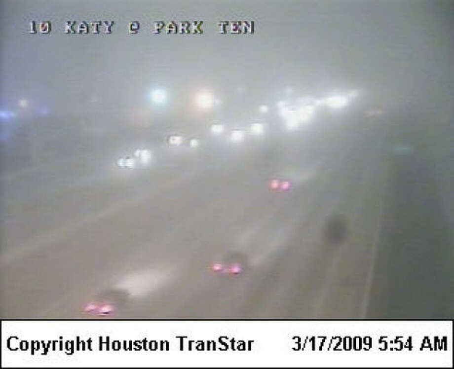 The Katy Freeway at Park Ten Boulevard is one of the areas where dense fog slowed the trip for commuters this morning.