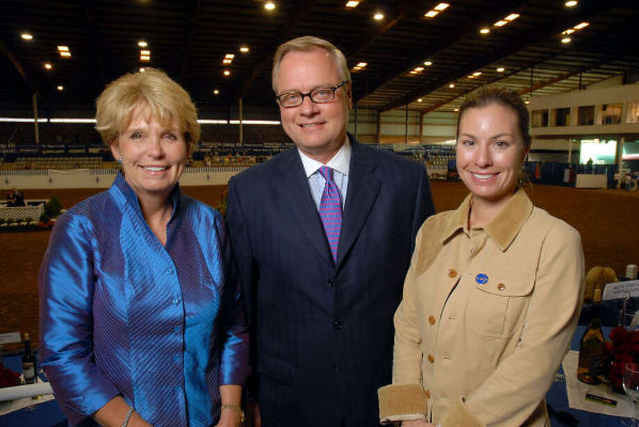 Pin Oak Charity Horse Show president Lynn Walsh, left, joined Rick Terry of BBVA Compass Bank, major underwriter of the show, and supporter Eva Bisso at the Ringside Championship Dinner & Gala held at the Great Southwest Equestrian Center. Photo: Dave Rossman, For The Chronicle