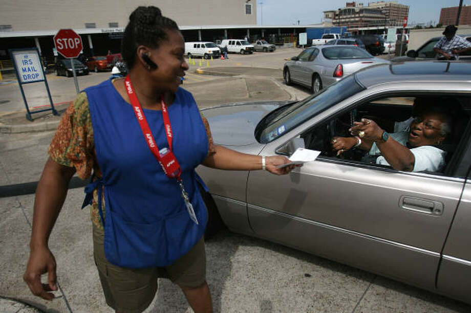 Belinda Gayle Williams receives motorist Ruth Wallace's annual letter to the Internal Revenue Service on Wednesday at the main post office downtown. Photo: Mayra Beltran, Chronicle