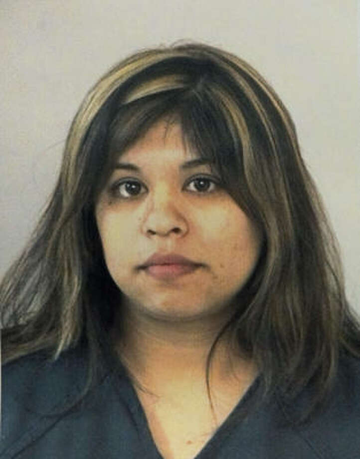Angela A. Lara, pictured in her booking mugshot, has pleaded guilty to aggravated robbery in connection with the December 2007 murder of retired school teacher Martha Fields in Fort Bend County. Authorities say she was the getaway driver, and two other men are charged with capital murder in the case. Photo: Fort Bend Co. Sheriff's Office