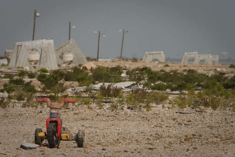 A child's tricycle and a backdrop of jumbled picnic shelters are reminders of what once was a popular park on the Texas City Dike before Hurricane Ike. The dike also featured a free-access fishing pier, a paved road, and a half-dozen popular boat ramps. Photo: James Nielsen, Houston Chronicle
