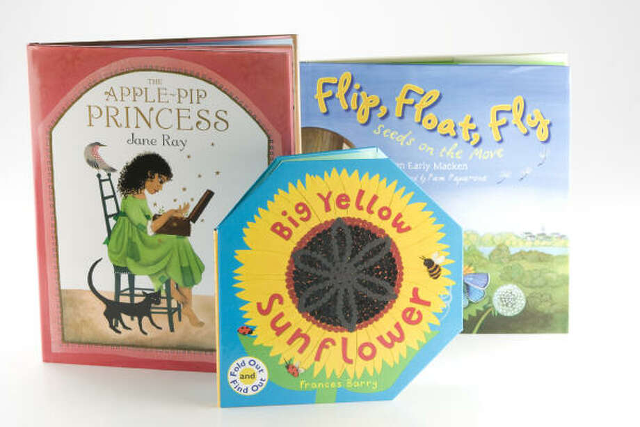 """""""The Apple-Pip,"""" by Jane Ray, """"Flip, Float, Fly: Seeds on the Move,"""" by JoAnn Early Macken and """"Big Yellow Sunflower,"""" by Frances Barry Photo: Brett Coomer, Chronicle"""