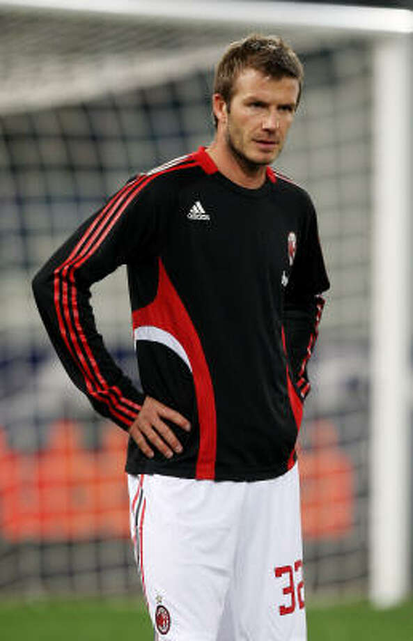 Midfielder David Beckham made his debut with AC Milan in a surprise start against AS Roma. Photo: Vittorio Zunino Celotto, Getty Images