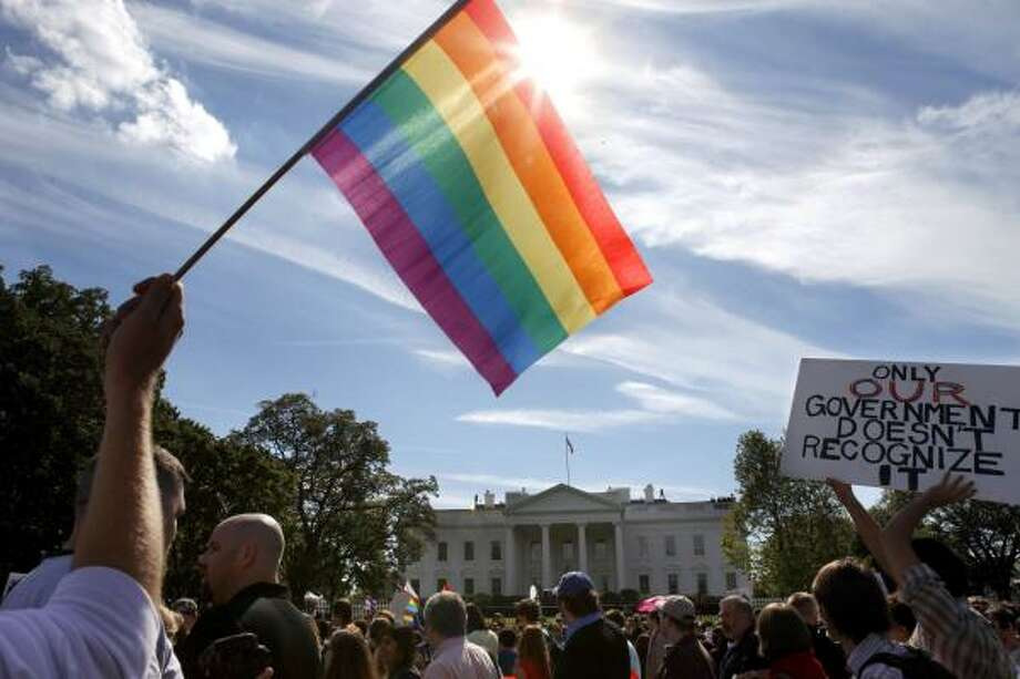 """We're out, we're proud, we won't back down,"" shouted thousands of gay rights advocates who marched from the Capitol to the White House on Sunday.  Photo: Jacquelyn Martin, ASSOCIATED PRESS"
