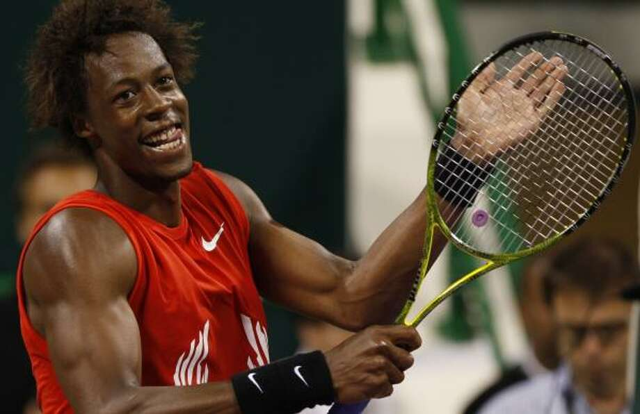 Gael Monfils of France reacts after defeating Spanish tennis player world number one Rafael Nadal during their quarterfinal match at the ATP Qatar tennis open in Doha, Qatar. Photo: Hassan Ammar, AP