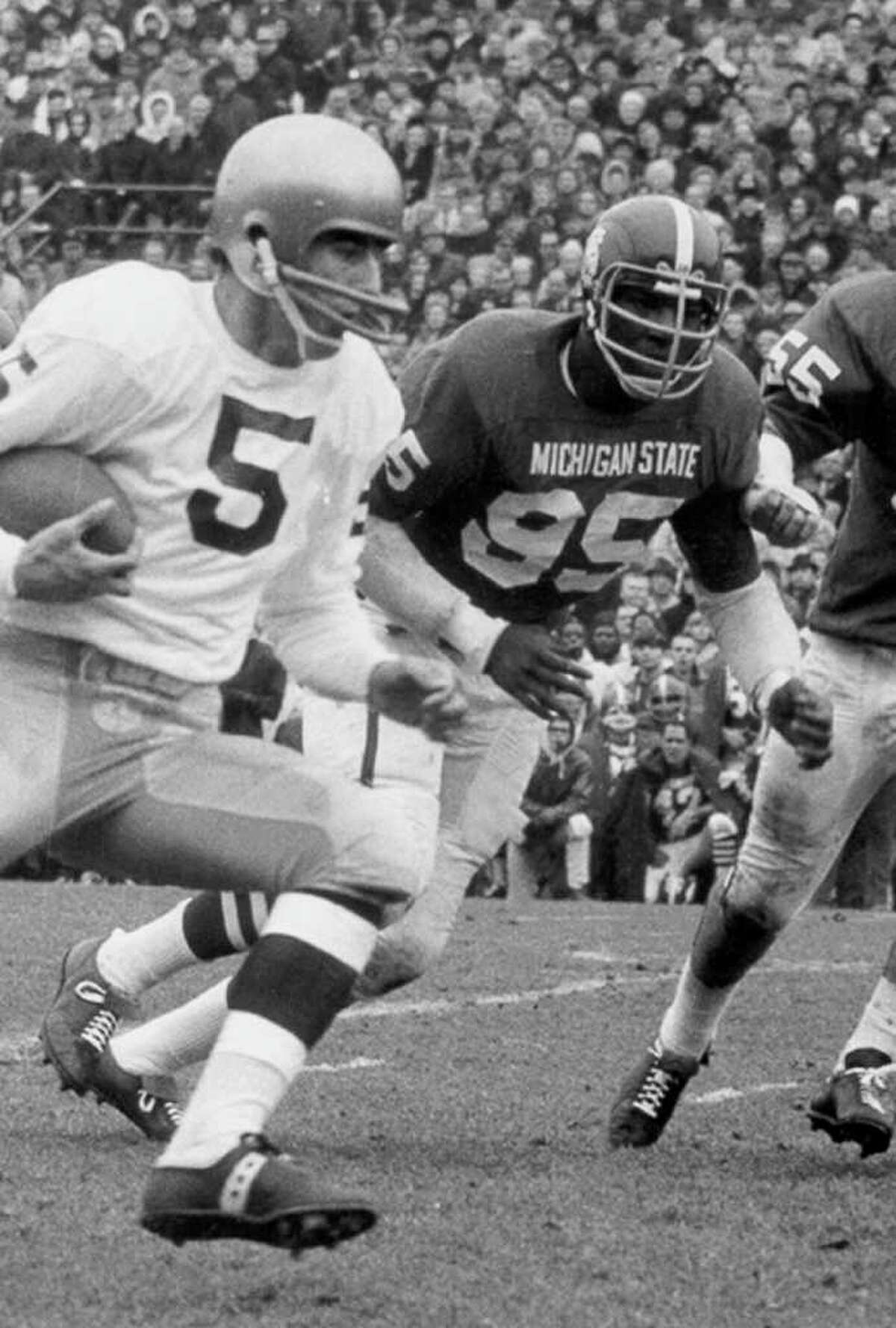 In a 1966 photo provided by Michigan State University, Michigan State's Bubba Smith, rear, chases down Notre Dame quarterback Terry Hanratty during a college football game in East Lansing, Mich. Smith, an NFL defensive star who found a successful second career as an actor, died Wednesday, Aug. 3, 2011, in Los Angeles at age 66. Los Angeles County coroner's spokesman Ed Winter said Smith was found dead at his Baldwin Hills home. Winter said he didn't know the circumstances or cause of death. (AP Photo/Michigan State University)