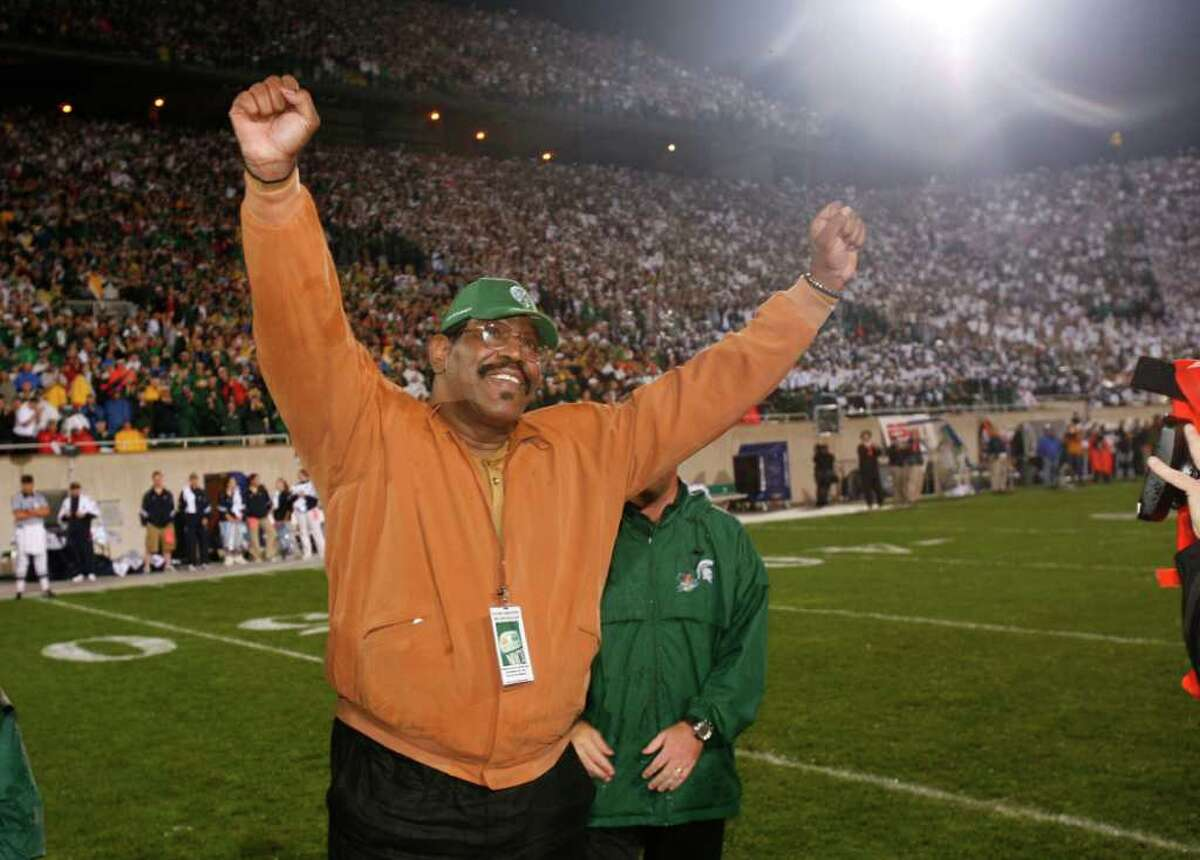 In this September 2006 photo provided by Michigan State University, former Michigan State football player Bubba Smith raises his arms during a ceremony at which his jersey number was retired, in East Lansing, Mich. Smith, a former NFL defensive star who found a successful second career as an actor, died Wednesday, Aug. 3, 2011, in Los Angeles at age 66. Los Angeles County coroner's spokesman Ed Winter said Smith was found dead at his Baldwin Hills home. Winter said he didn't know the circumstances or cause of death. (AP Photo/Michigan State University)