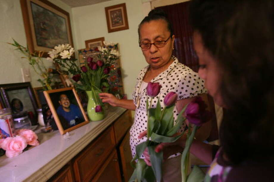 Paula Valdez has erected an altar honoring her late son, Reynaldo. Photo: Mayra Beltran, Chronicle