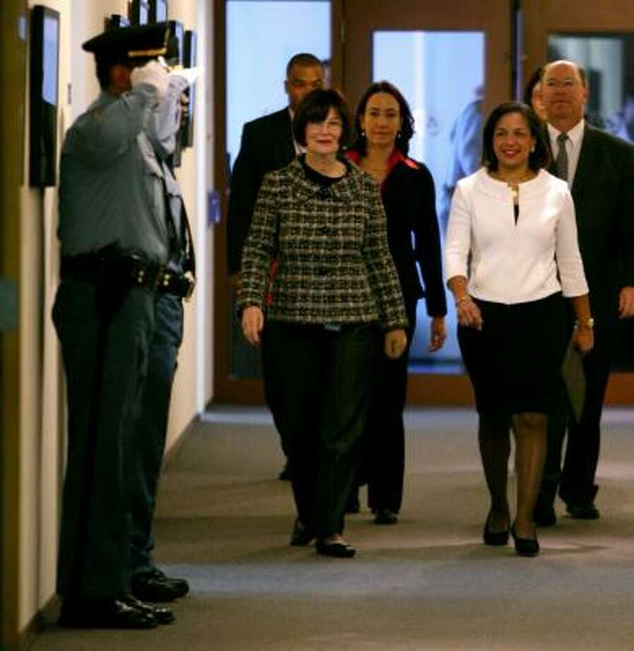 U.N. officers salute Susan Rice, right, on Jan. 26 — her first day at the United Nations. Photo: BEBETO MATTHEWS, AP