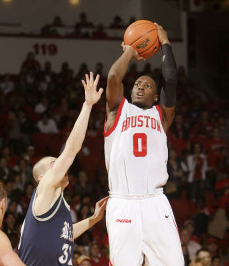 UH guard Kelvin Lewis is the team's second-leading scorer and is often assigned to guard the opponent's best player. Photo: Bob Levey, For The Chronicle
