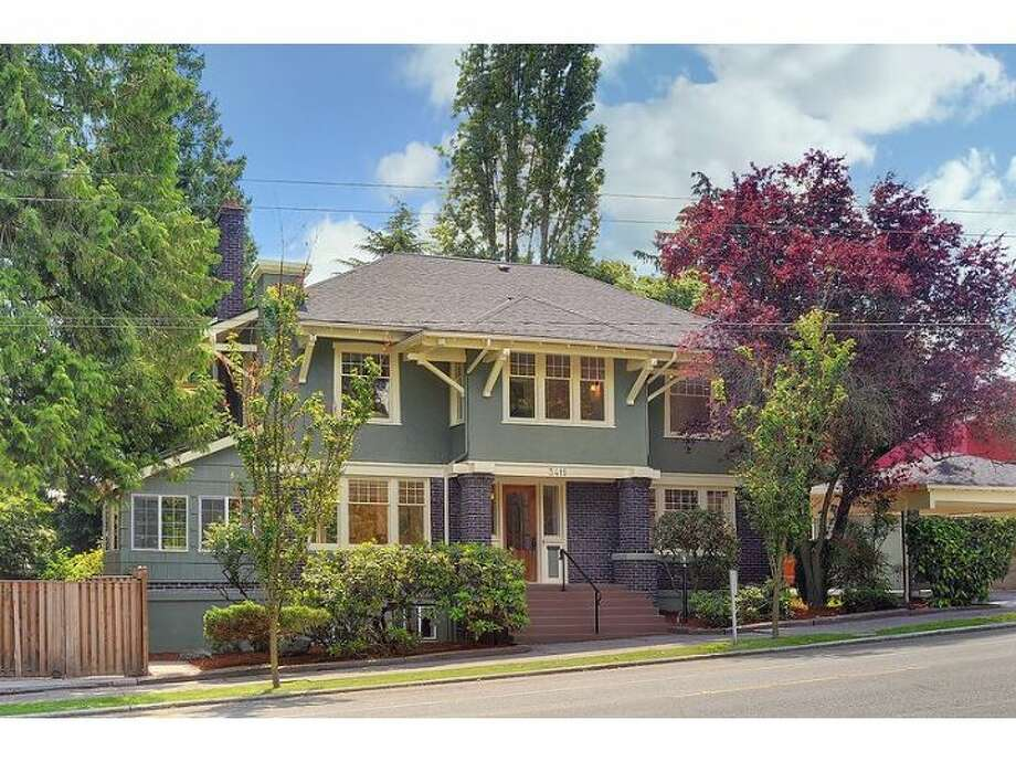 Here's a grand Craftsman home in Seattle's Mount Baker neighborhood. The 4,180-square-foot house was built in 1914 and has five bedrooms, 2.5 bathrooms,massive moldings, period fixtures, radiators a master bedroom with a fireplace, a lower-level apartment and a 4,180-square-foot lot across the street from Mount Baker Park. It's listed for $899,000. (Listing: www.windermere.com/index.cfm?fuseaction=listing.listingDetailUpdated&listingID=130261537) Photo: Windermere Real Estate