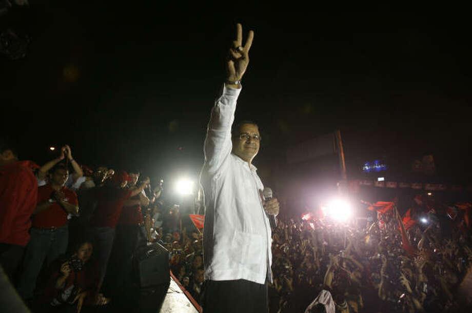 Mauricio Funes' victory has raised fears of a communist regime. Photo: Dario Lopez-Mills, Associated Press