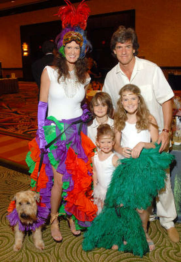 Erin and Nick Florescu and their children — Nicky, 7, Isabella, 9, and Ava, 4 — dressed Rio style along with their dog, Baloo. The six took first place in the Citizens for Animal Protection competition. Photo: DAVE ROSSMAN