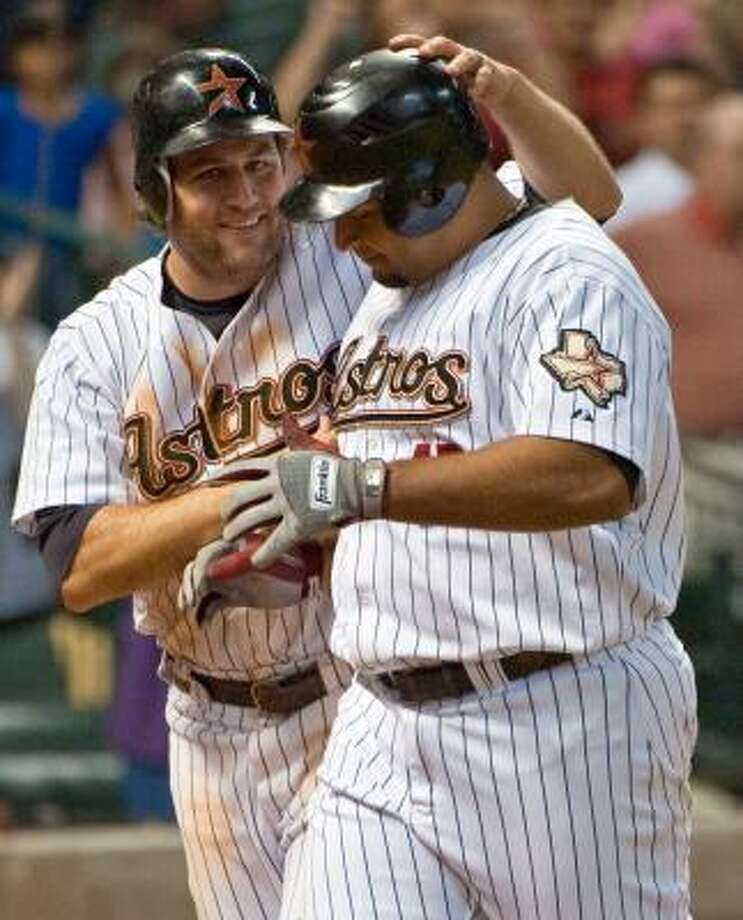 Lance Berkman, left, and Carlos Lee both homered in the Astros' win. Photo: Dave Einsel, AP