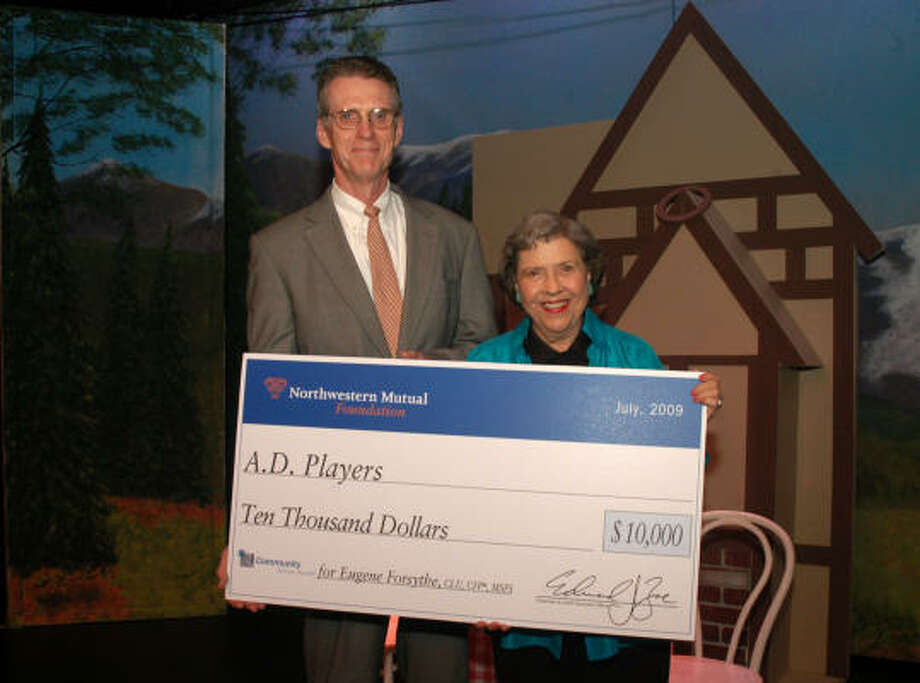 BIG CHECK: Gene Forsythe and Jeannette Clift George hold the oversized $10,000 check, donated to the A.D. Players through an Outstanding Volunteer Award Program through his employer, Northwestern Mutual. Photo: Courtesy Photo, For The Chronicle