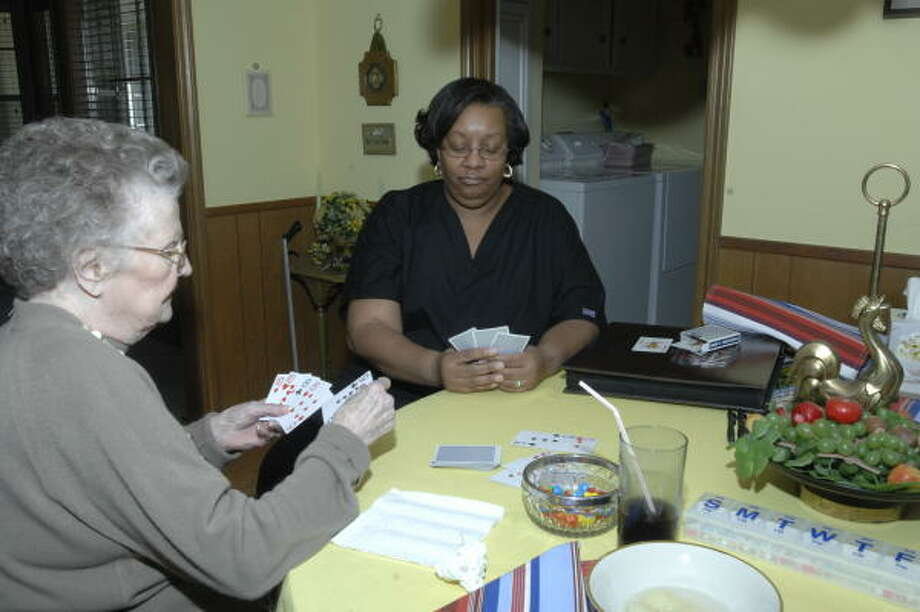 Lois Bayless, left, and her in-home caregiver Gertrude Winn enjoy each other's company. They play gin rummy daily. Photo: Eddy Matchette, FOR THE CHRONICLE
