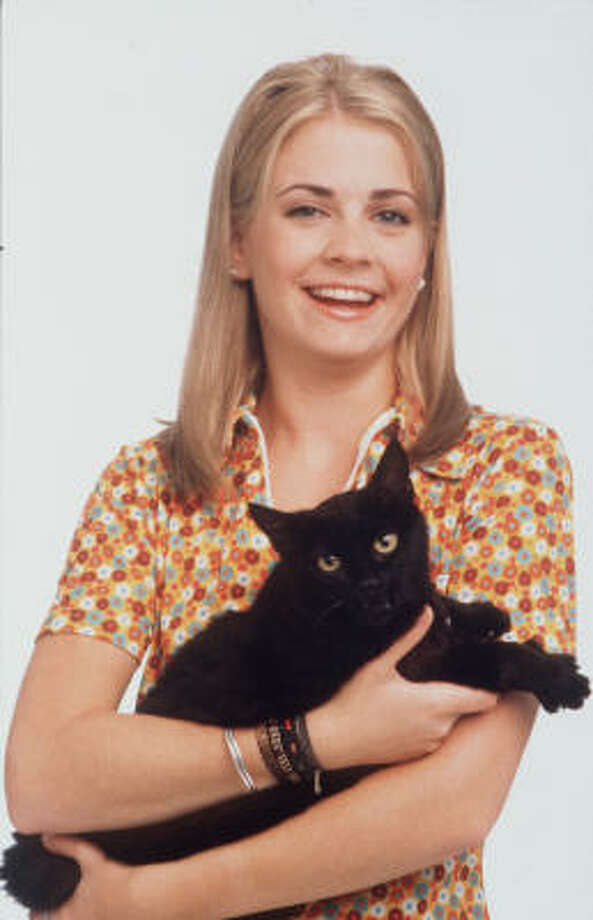 Melissa Joan Hart with Salem. Photo: Lange, ABC