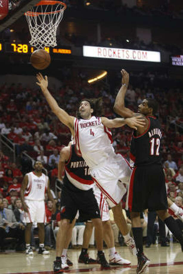 Rockets forward Luis Scola (4) came up big against Portland in Game 3, scoring 19 points in a 86-83 win Photo: Brett Coomer, Chronicle