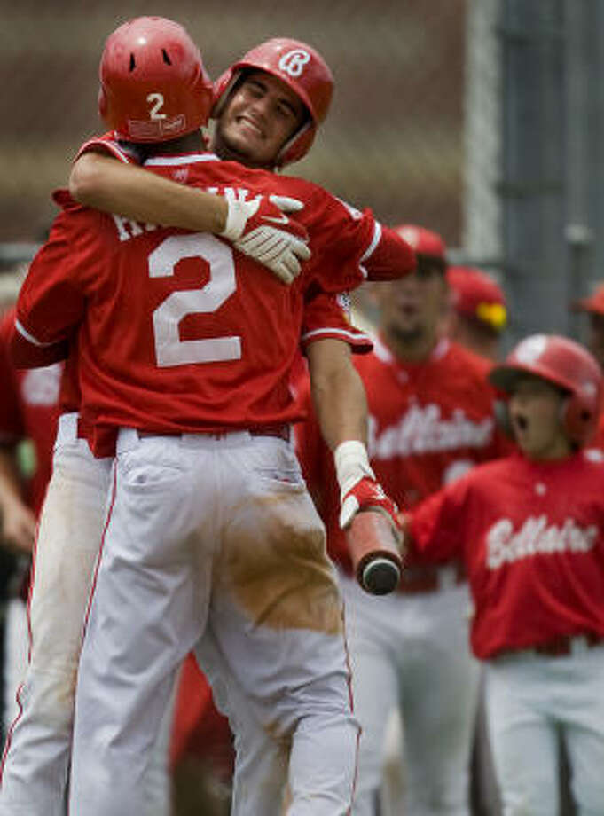 Bellaire's Jarrett Higgins (2) celebrates with teammate Alex Silver after Higgins' steal of home during the fifth inning. Photo: Smiley N. Pool, Chronicle