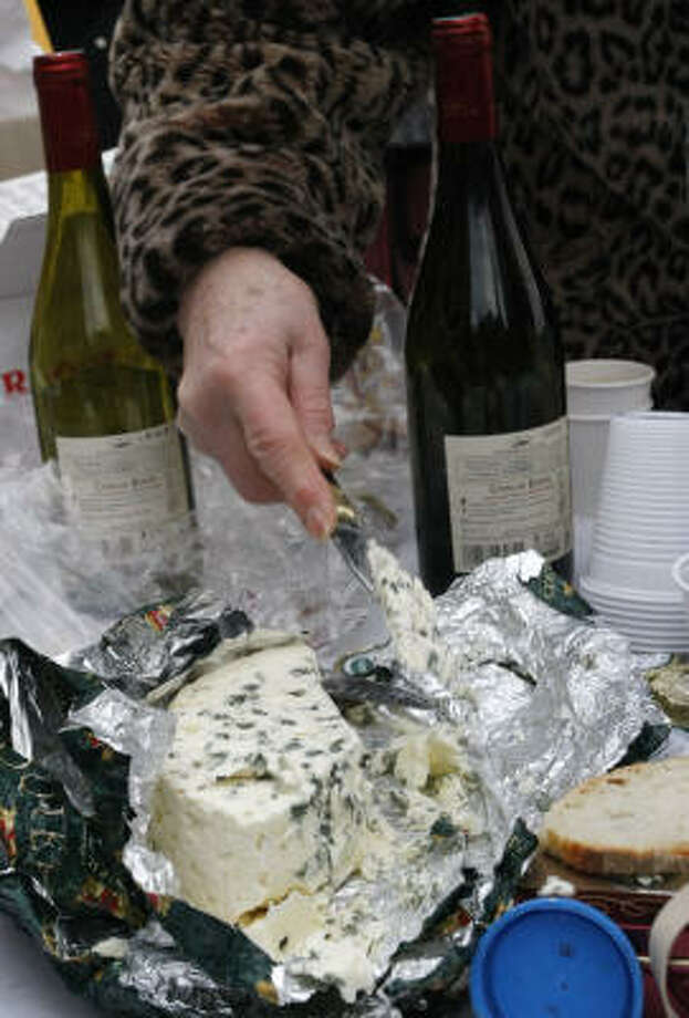 Roquefort cheese is served at a protest near the U.S. Embassy in Paris. Photo: THIBAULT CAMUS, Associated Press