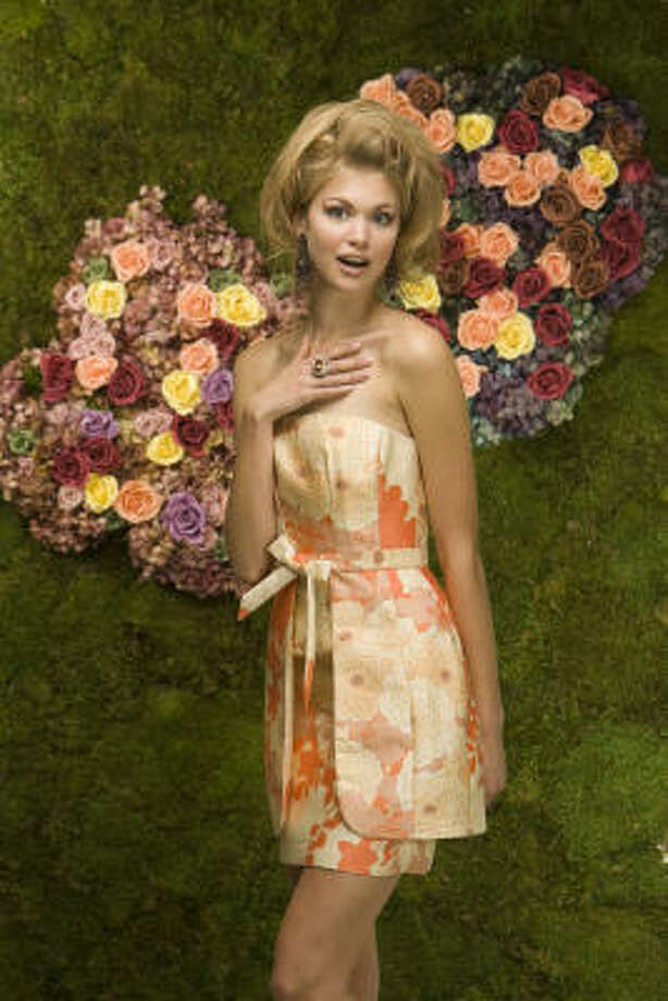 SORBET HUES: Allyson Cook of Page Parkes Models wears a Tracy Reese dress, $425 at Nordstrom. Earrings, $340, and ring, $100 at Neiman Marcus. Hair and makeup by Kathy White of Pastorini-Bosby Talent. Styling by Dawn Bell. Backdrop by David Brown Flowers and Verdissimo. Photo: Nick De La Torre, CHRONICLE