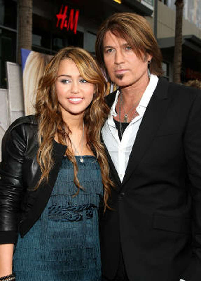 Actress-singer Miley Cyrus and her father, actor-singer Billy Ray Cyrus, also play father and daughter in a new Disney film, Hannah Montana: The Movie. Photo: Alberto E. Rodriguez, Getty Images