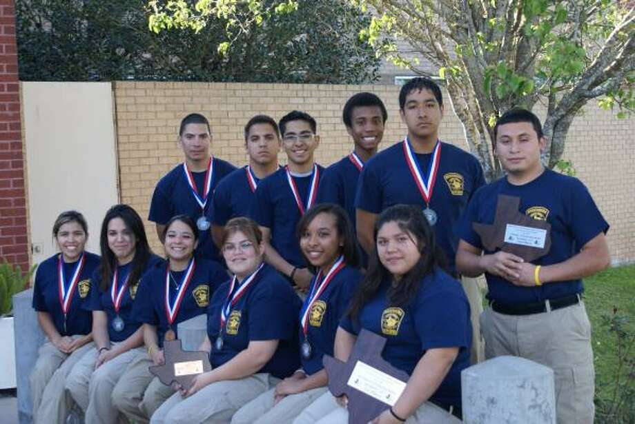 Members of the Rosenberg Police Explorers Post included, from left, front: Christina Barr, Courtney Lopez, Alexis Varella, Donna White, Jenae Butler and Laura Palacios; standing: Andrew Lopez, Carlos Becerra, Alex Medina, Ranndy Reed, Jimmy Lewis and Sinue Contreras. Not pictured is Malcolm Gipson Photo: Rosenberg Police Department
