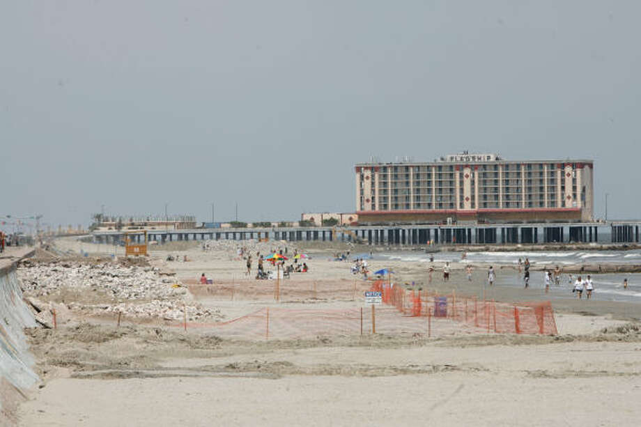 Rocks were exposed May 21 along the Seawall where the Army Corps of Engineers was working to rebuilding the beach. The corps cautioned visitors to be careful in construction areas. Photo: Julio Cortez, Chronicle