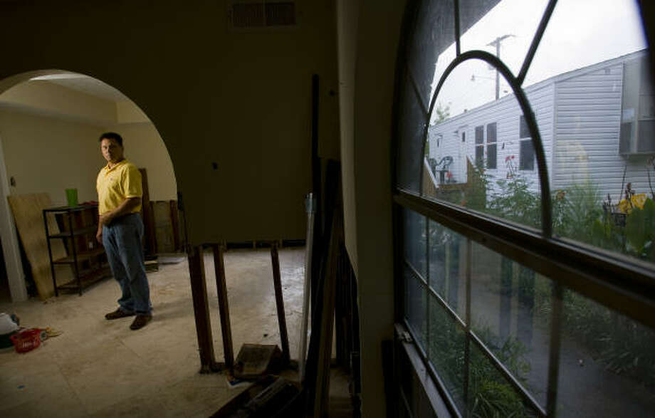 Michael Amoroso has salvaged everything he can from his house in Dickinson, still empty and scarred from Hurricane Ike, but says he needs a bigger insurance payment to rebuild. Photo: Karen Warren, Chronicle
