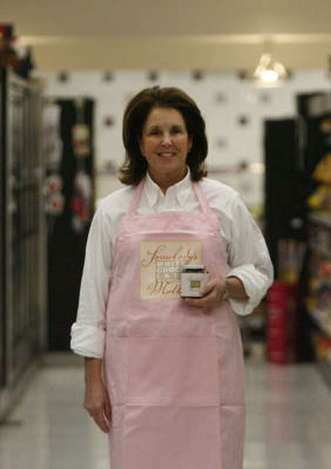 Lynn Lasher's all-natural sauce is meant to be poured over ice cream or cake and to make chocolate martinis. Photo: Julio Cortez, Chronicle