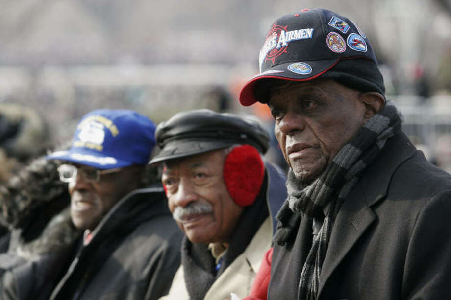 PROUD: Members of the Tuskegee Airmen, the country's first group of black military pilots and crew, sing the national anthem during the inauguration in Washington. Photo: RYAN ANSON, AFP/Getty Images