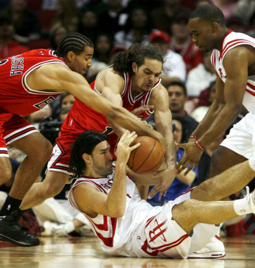 Rockets forward Luis Scola hits the floor for a loose ball as Bulls guard Thabo Sefolsha, left, and forward Joakim Noah try to take the ball away. Photo: Eric Kayne, Chronicle