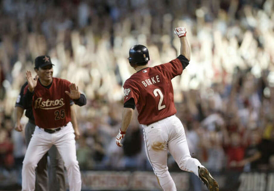 Chris Burke's home run to win the longest playoff game in baseball history is one of Minute Maid Park's best moments. Photo: Karen Warren, HOUSTON CHRONICLE