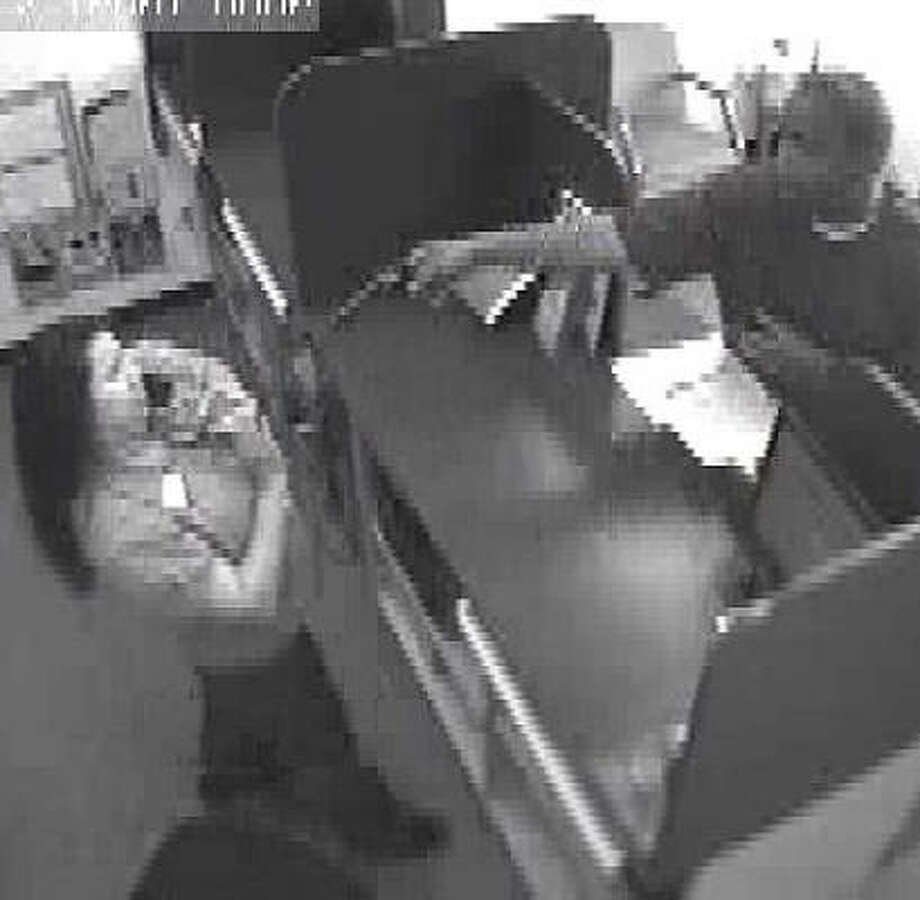 This image of the suspect was taken at EZ Loan Services on Kempwood. Photo: HPD