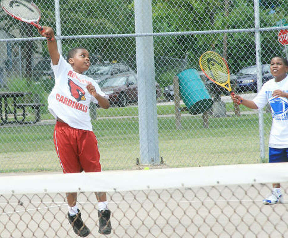 Kyle Johnson and Roy Limbridge play tennis last weekend at Emancipation Park. Photo: Pin Lim, For The Chronicle