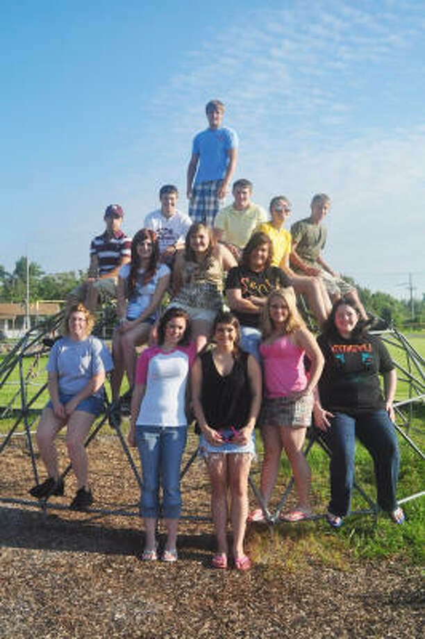 SMALL CLASS: All but four members of the Class of 2009 at High Island High School on the Bolivar Peninsula gathered for this photo on the school grounds. Photo: Jimmy Loyd, For The Chronicle