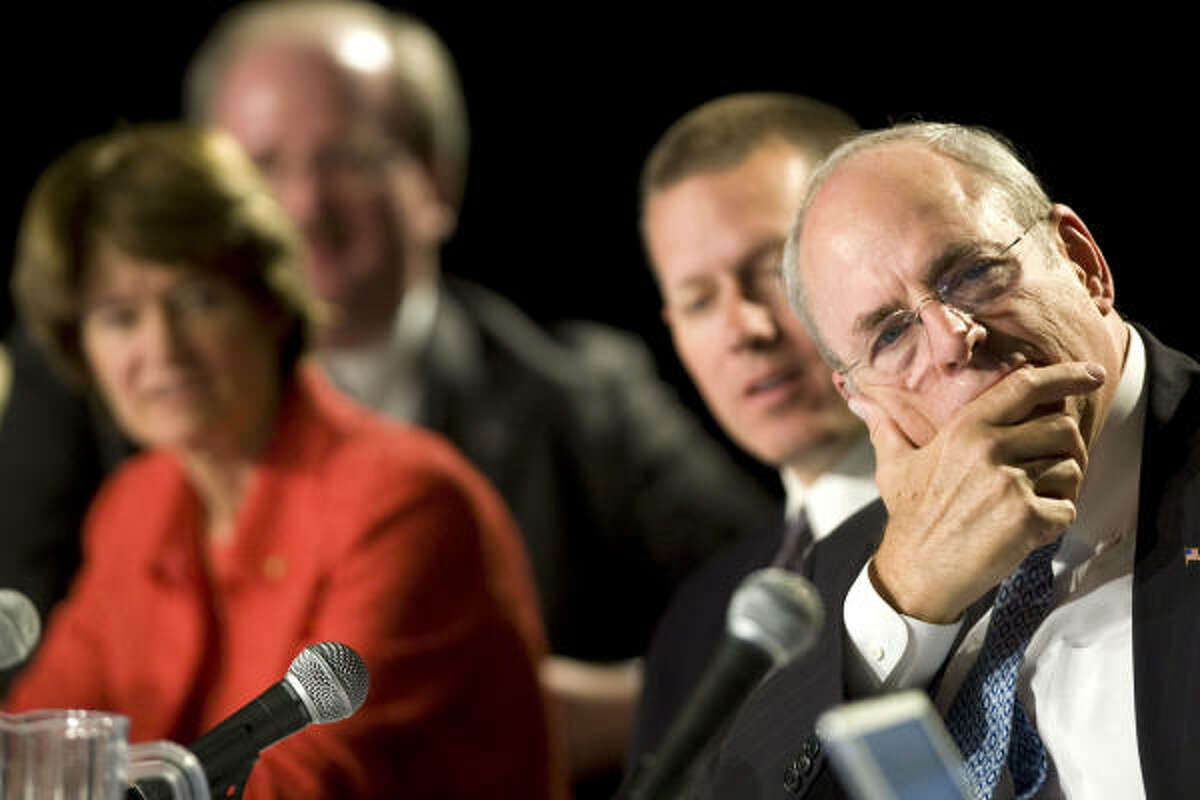 Former astronaut Sally Ride and Norman Augustine, right, listen to public comments at Johnson Space Center.