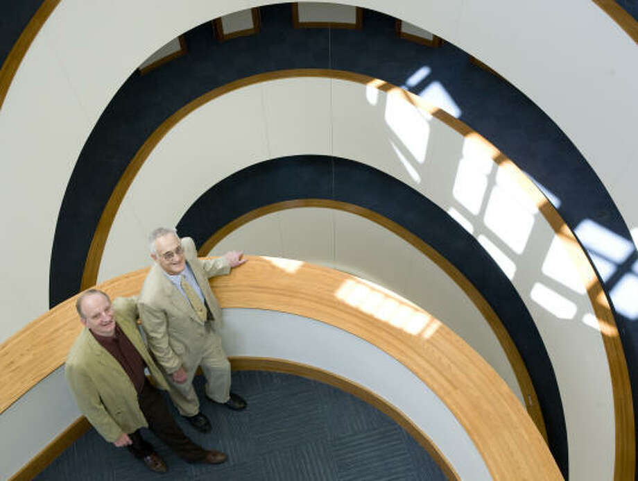 Texas A&M's department head for physics, Dr. Ed Fry, left, gives a tour to 1996 Nobel Prize winner Dr. David M. Lee at the George P. and Cynthia Woods Mitchell Institute for Fundamental Physics and Astronomy and the George P. Mitchell '40 Physics Building on Monday in College Station. Photo: ALL