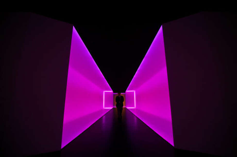 "Museum goers walk through James Turrell's ""The Light Inside"" at the Museum of Fine Arts, Houston. Photo: Michael Paulsen, Chronicle"