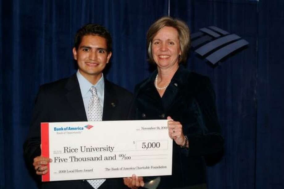 Baytown-area resident Tony Castilleja Jr. was awarded a 2009 Neighborhood Excellence Initiative Award by Kim Ruth, Texas State President at Bank of America. Photo: Submitted Photo